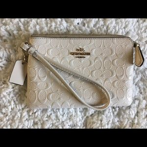 Gently used coach Wristlet (color offwhite)